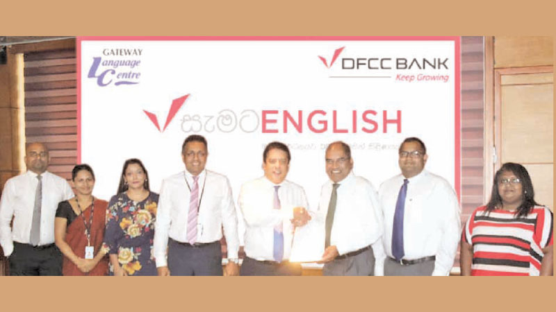 Lakshman Silva, CEO of DFCC Bank exchanges the agreement with Dr Harsha Alles, Chairman Gateway Group. Also in the picture; L-R Buddhika Srikantha, Assistant Channels Marketing Manager, DFCC Bank, Thanusshi Dissanayake, Legal Officer, DFCC Bank, Nilmini Gunaratne, Vice President Marketing DFCC Bank, Thimal Perera Deputy CEO, DFCC Bank, Ramantha Alles, Director, Gateway Group and Wathsala Dissanayake, Manager Gateway Language Centre