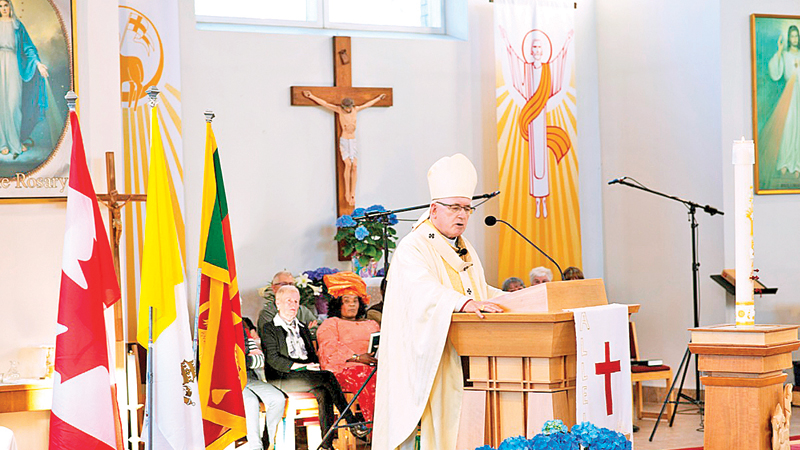 Archbishop Terrence Prendergast conducting Holy Mass.