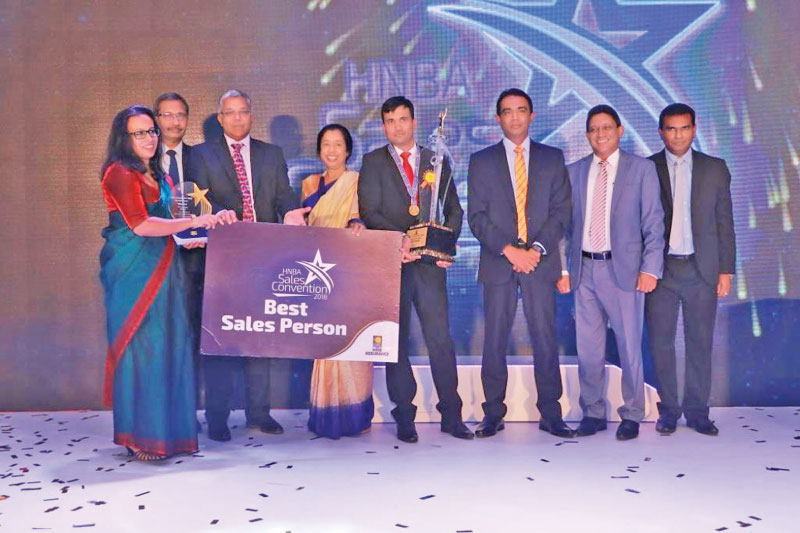 Best Sales Person of the Year T.G. Rohana together with the Chief Operating Officer of HNBA Prasantha Fernando, Managing Director and CEO of HNBA and HNBGI Deepthi Lokuarachchi, Chairperson of HNBA and HNBGI Rose Cooray, HNBA Deputy Chief Operating Officer Lasitha Wimalaratne, HNBA Chief Business Officer Ivan Nicholas and HNBA Head of Distribution Hiran Fernandopulle.