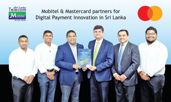 Exchanging of the partnership agreement between Nalin Perera Mobitel, Chief Executive Officer and Santosh Kumar Mastercard Country Manager, Sri Lanka and the Maldives R. B. Kalhara Gamage Mobitel General Manager and Mobile Financial Services, Isuru Dissanayake Mobitel Senior General Manager Marketing, Sandun Hapugoda Mastercard Head, Digital Payments, Sri Lanka and Gayan Kalugamage Maldives and Mobitel Assistant Manager - Mobile Financial Services.