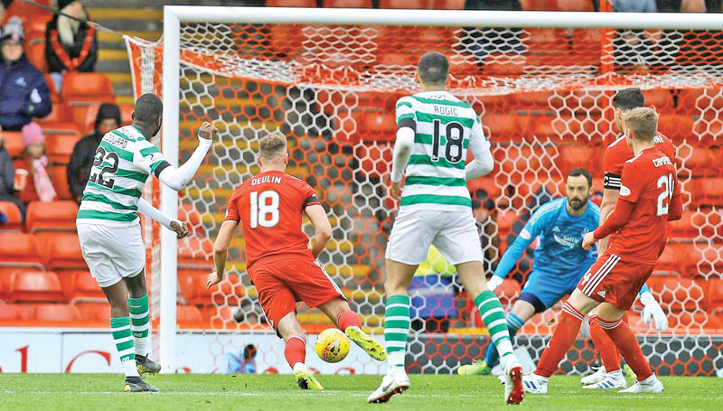 Celtic's Odsonne Edouard scores their third goal against Aberdeen.