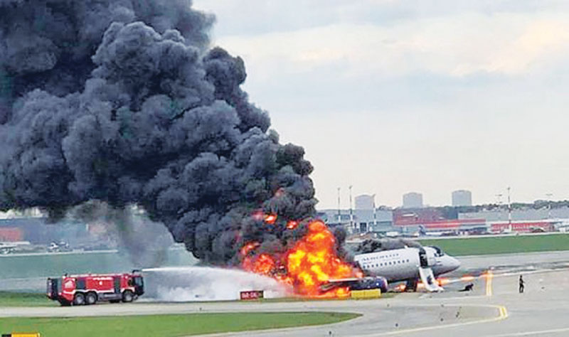 Smoke billows from the plane.