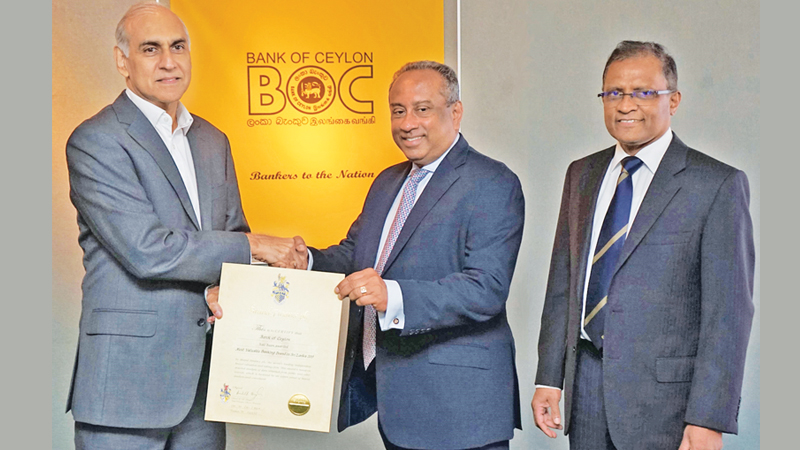 """Brand Finance Lanka Managing Director Ruchi Gunawardene, hands over the """"Most Valuable Banking Brand"""" certificate to the Bank's Chairman, President's Counsel Ronald C. Perera. The Bank's CEO/ General Manager Senarath Bandara is also in picture."""