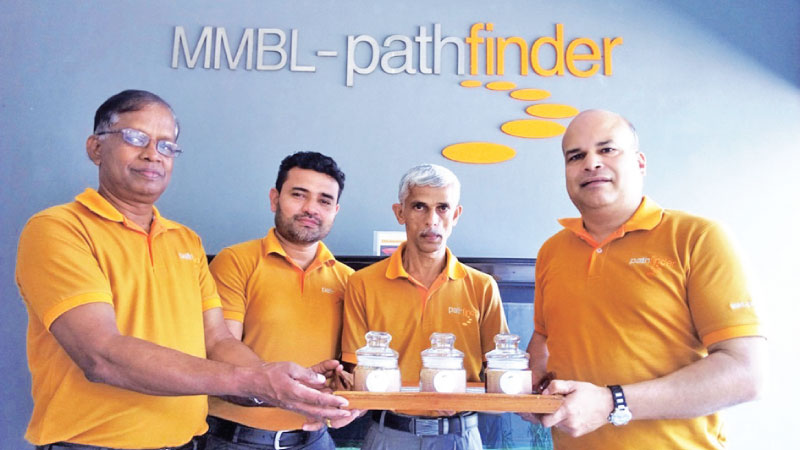 Presentation of the first Bee's honey to MMBL-Pathfinder  Founder Milinda Moragoda at Riverpoint by Staff members L Lalith, Sumudu Ruwan, and K.D. Liyanage