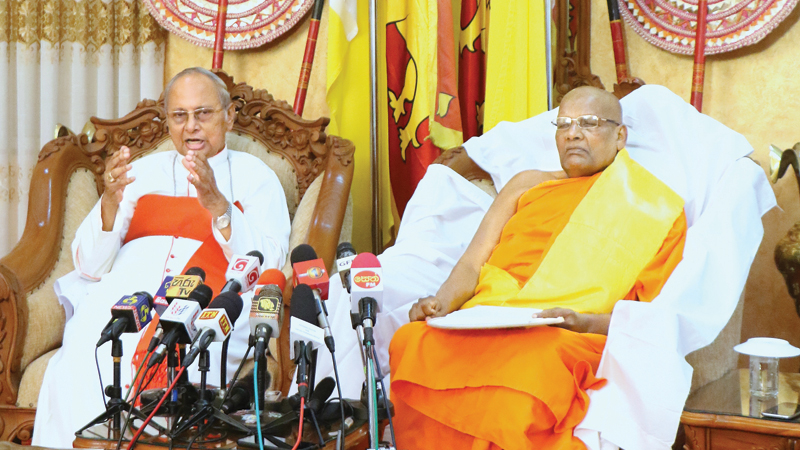Archbishop of Colombo His Eminence Malcolm Cardinal Ranjith and the Chancellor of the University of Sri Jayawardanepura Dr. Ittapana Dhammalankara Maha Nayake Thera speaking during a joint media briefing convened at Bishop's House in Colombo recently. Picture by Saman Sri Wedage