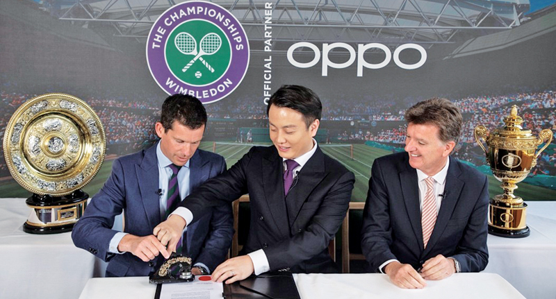 Signing of agreement between Brian Shen, Vice President for OPPO, Tim Henman, AELTC Committee Member, and Mick Desmond, Commercial & Media Director, AELTC at the All England Club.