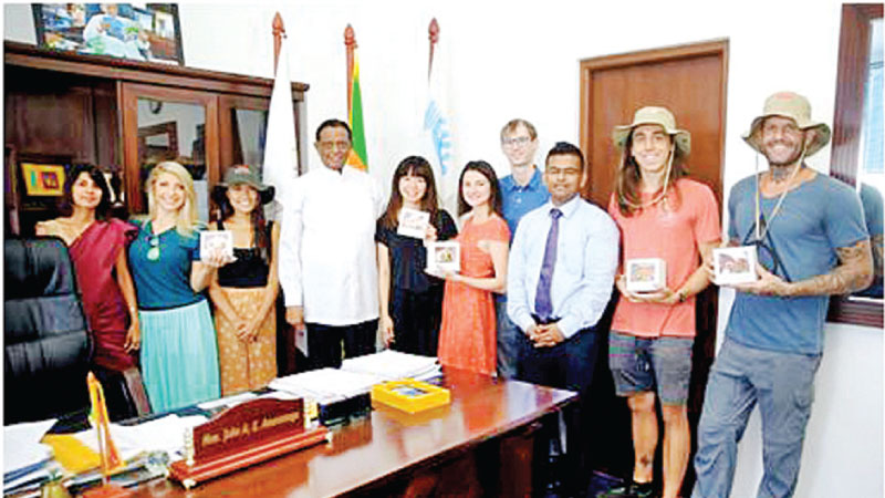 The group with Minister Amaratunga