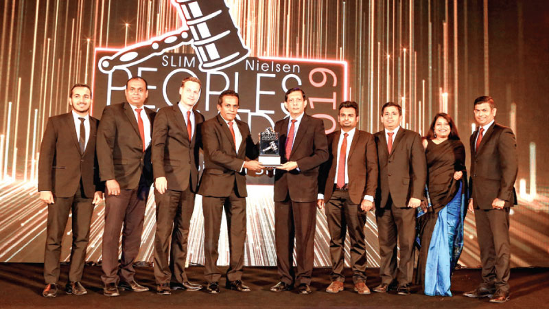 INSEE SANTHA officials receiving the award.