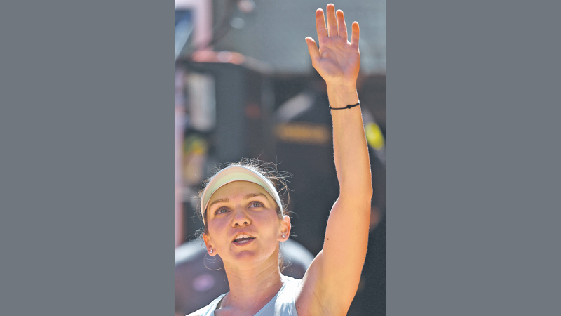 Romania's Simona Halep celebrates defeating Switzerland's Belinda Bencic during  their WTA Madrid Open semi-final tennis match at the Caja Magica in Madrid on May 10, 2019. (AFP)