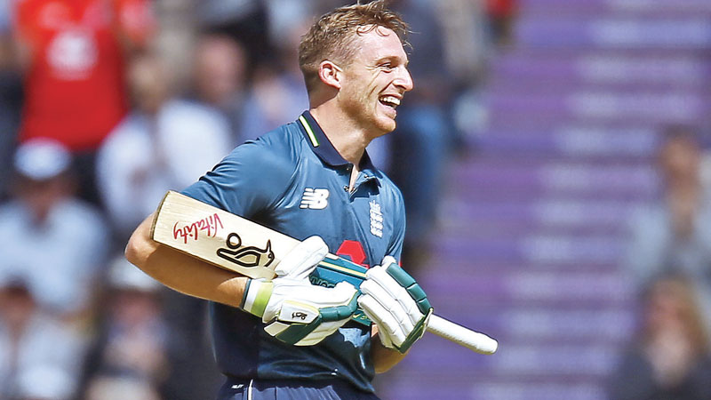 England's Jos Buttler celebrates reaching hundred during the second One Day International (ODI) against Pakistan at The Ageas Bowl in Southampton on Saturday. – AFP