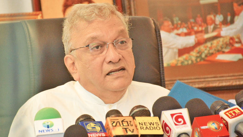 Leader of the House and Minister Lakshman Kiriella addressing yesterday's press conference.  Picture by Sarath Peiris