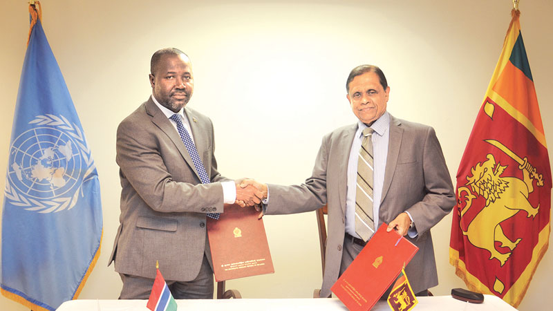 Dr. Amrith Rohan Perera, Sri Lankan Ambassador and Permanent Representative the UN and Gambian Ambassador and Permanent Representative of Gambia to the UN, Lang Yabou, at the signing of the agreement.