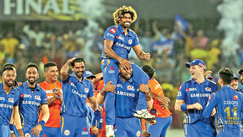 Lasith Malinga is carried head high by his Mumbai Indians team mates following their one-run win over Chennai Super Kings in the IPL final at Hyderabad on Sunday.
