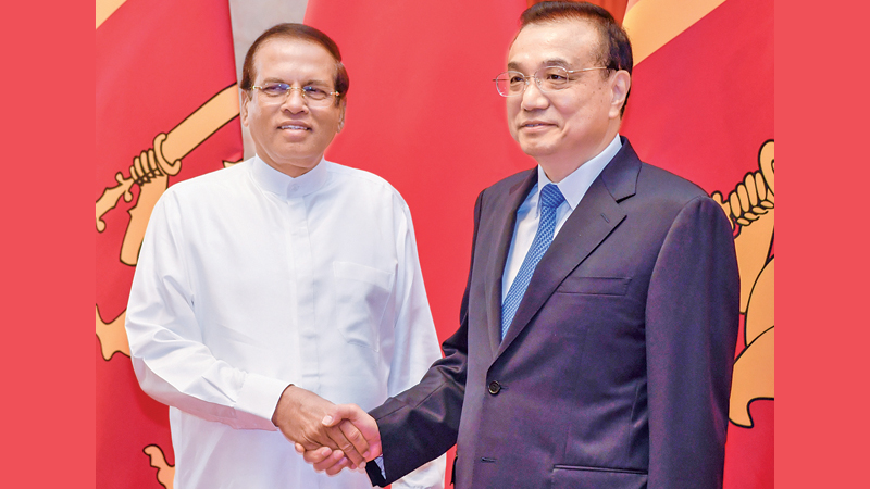 President Maithripala  Sirisena  who is on an official visit to  China yesterday met Chinese Prime Minister Li Keqiang in Beijing.  Picture by Kapila Ariyawansa