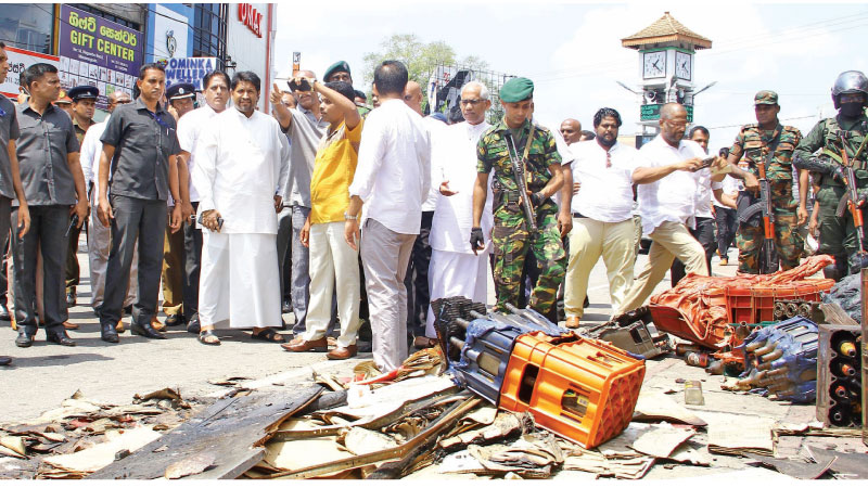 Acting Defence Minister Ruwan Wijewardene and State Finance Minister Eran Wickramaratne inspected the security conditions in Minuwangoda where riots were reported on Monday. Parliamentarian Harshana Rajakaruna was also present. Picture by Hirantha Gunathilake.