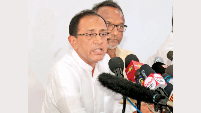 Minister Kabir Hashim and Imthiaz Bakeer Markar speaking at yesterday's press conference. Picture by Shan Rambukwella