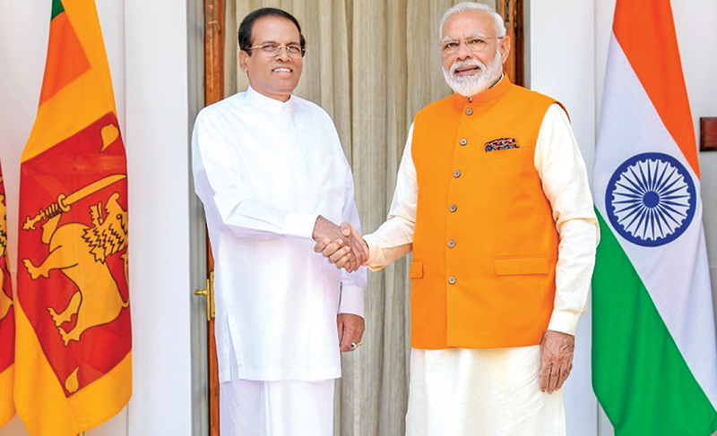 President Maithripala Sirisena met with Indian Prime Minister Narendra Modi at Hyderabad House in New Delhi yesterday. Picture by Sudath Silva