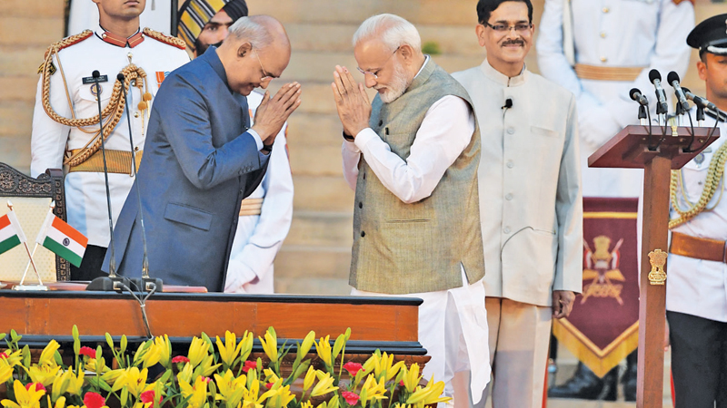 Newly sworn-in Indian Prime Minister Narendra Modi gestures towards Indian President Ram Nath Kovind after taking the oath of office as India's Prime Minister at the President House in New Delhi on Thursday. -  AFP