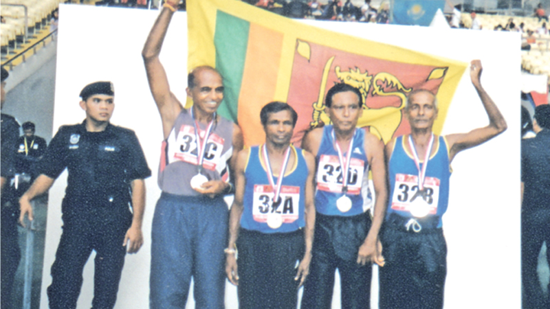 After winning the Gold Medal at the Asian Masters 4x400 metre Relay Event at Bulkith Jaleel Stadium in Malaysia the team pose for a photograph. Standing (from left): K. M. Karunarathne, S. H. Amaradasa, Bandara and Carl Fernando. (Picture by Dilwin Mendis, Moratuwa Sports Special Correspondent)