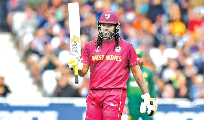 West Indies' Chris Gayle celebrates his half century during the 2019 Cricket World Cup group stage match between West Indies and Pakistan at Trent Bridge in Nottingham, central England.