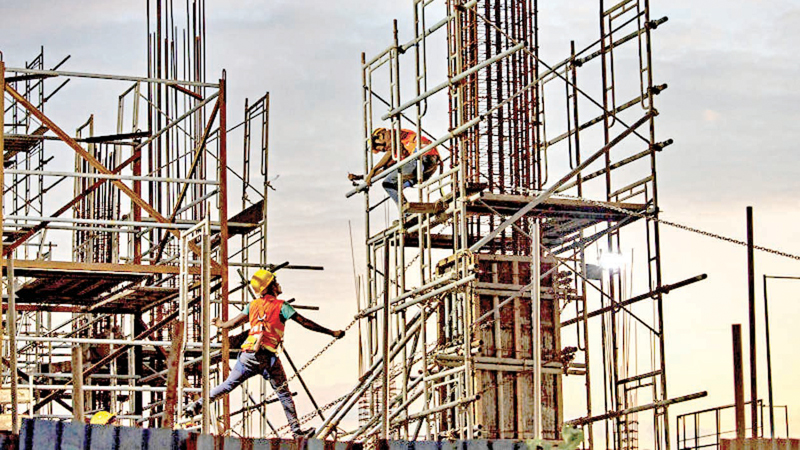 Chinese workers construct a shopping mall at a retail and office complex, part of a Chinese-backed building boom in Colombo.