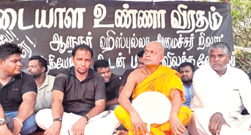 Batticaloa District TNA Parliamentarian S. Viyalendran and his supporters who are on a hunger strike. (Picture by Sivam Packiyanathan.)