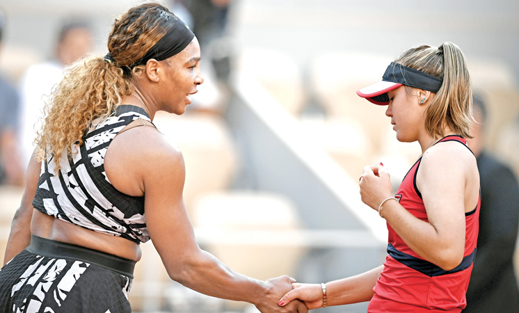 Sofia Kenin of the US (R) and Serena Williams of the US shake hands at the end of their women's singles third round match on day seven of The Roland Garros 2019 French Open tennis tournament in Paris on Saturday. – AFP