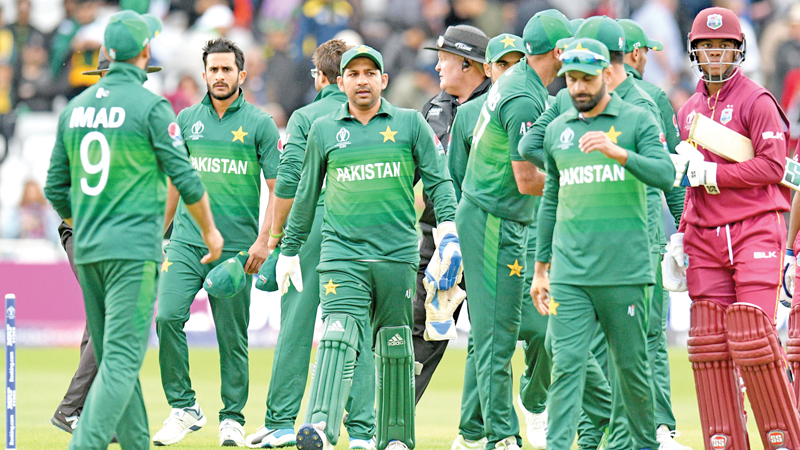 Pakistan's cricketers leave the field at end of the World Cup group stage match against West Indies at Trent Bridge, Nottingham. - AFP