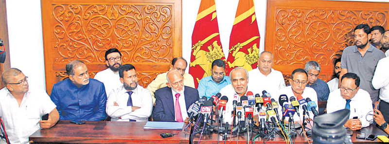 Former Ministers Rauff Hakeem, Kabir Hashim, M.H.A. Haleem, Rishard Bathiudeen and former State Ministers Ali Zahir Maulana, Faizer Cassim, Ameer Ali, H.M.M. Harees and Deputy Minister Abdulla Mohammed Maharoof addressing the press conference  at Temple Trees yesterday. Former Minister A.H.M Fowzie is also in the picture. Picture by  Sulochana Gamage