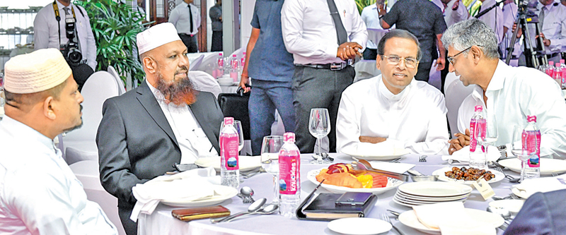 President  Maithripala Sirisena and Parliamentarian Faiszer Mustapha at the National  Ifthar Ceremony  yesterday. Picture by Sadaruwan Amarasinghe