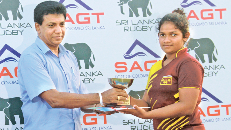 Col (retd) Dhammika Gunasekera presenting a trophy during the Inter-Club Women's Rugby Sevens tournament. (Picture by Wasitha Patabendige)