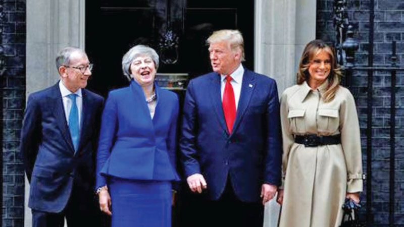 U.S. President Donald Trump and First Lady Melania Trump meet Britain's Prime Minister Theresa May and her husband Philip at Downing Street as part of his state visit in London yesterday.