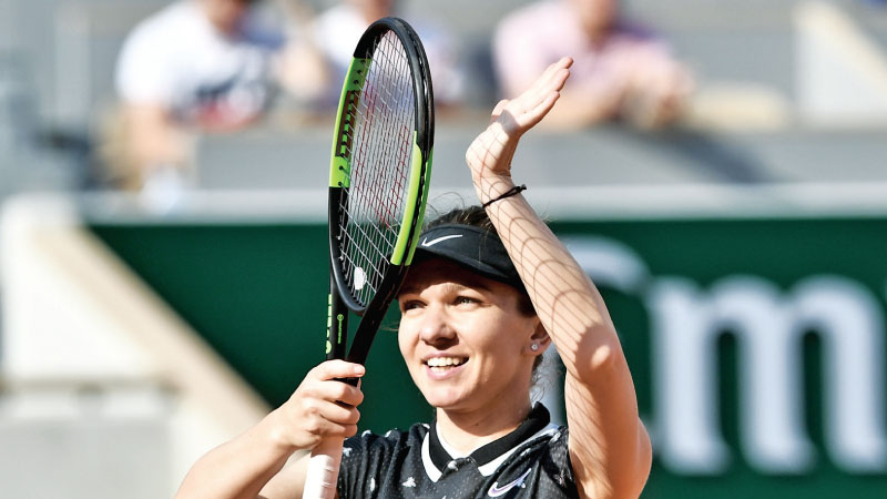 Romania's Simona Halep celebrates after winning against Poland's Iga Swiatek during their women's singles fourth round match on day nine of The Roland Garros 2019 French Open tennis tournament in Paris on June 3. AFP