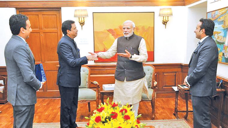 Chairman CG Corp Global Dr Binod Chaudhary at a prior discussion with Indian PM Narendra Modi. Directors Rahul Chaudhary and Varun Chaudhary look on.