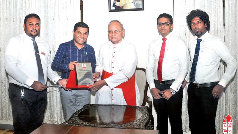 The donation of i-Panel being handed over to Archbishop of Colombo cardinal, Malcolm Ranjithat his official residence, by Sampath Mayakaduwa, Chairman, Idea Group Limited.