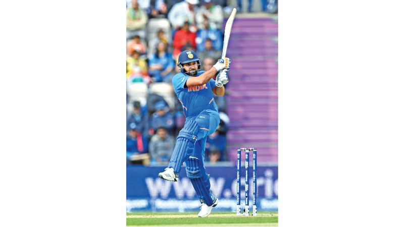 India's Rohit Sharma plays a shot during the 2019 Cricket World Cup group stage match between South Africa and India at the Rose Bowl in Southampton, Southern England, on June 5. AFP