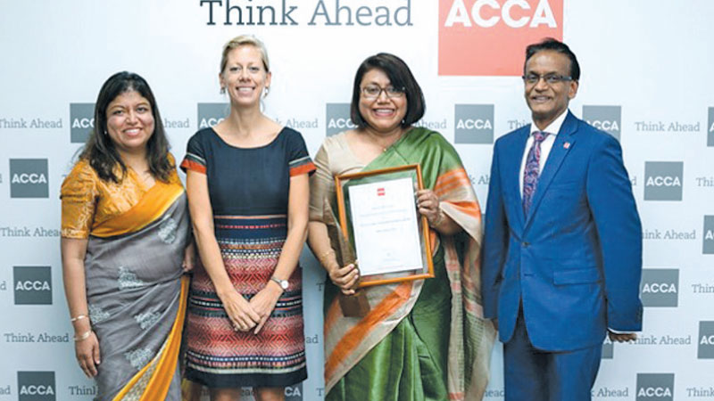 Nilanthi Sivapragasam, Chief Financial Officer of Aitken Spence  with the award.