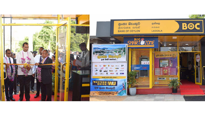 State Minister of Tourism Development, Wildlife and Christian Religious Affairs Ranjith Aluvihare, Bank's Chairman, President's Counsel Ronlad C. Perera and CEO/ General Manager Senarath Bandara ceremoniously opening the Laggala Branch by cutting the ribbon. The DGM Sales and Channel Management C. Amarasinghe is also in the picture