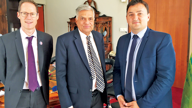 Prime Minister Ranil Wickremesinghe with Deputy Mayor of Paris Jean François Martins (right) and Agence Francaise de Developpement Country Director Martin Parent.