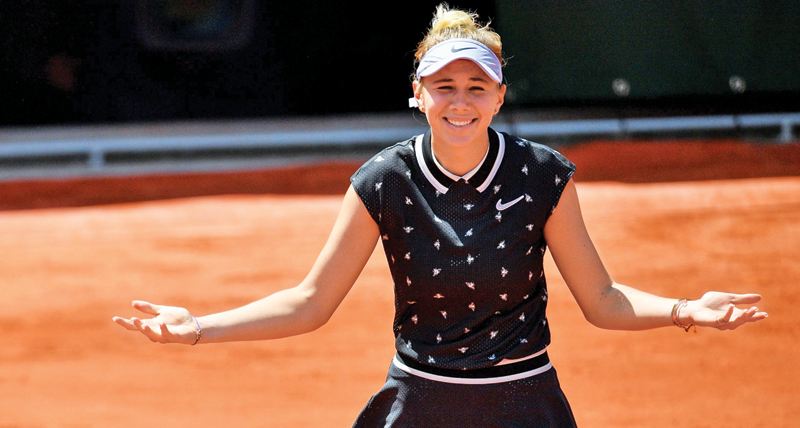 Amanda Anisimova of the US celebrates after winning against Romania's Simona Halep on day twelve of The Roland Garros 2019 French Open tennis tournament in Paris on Thursday. - AFP