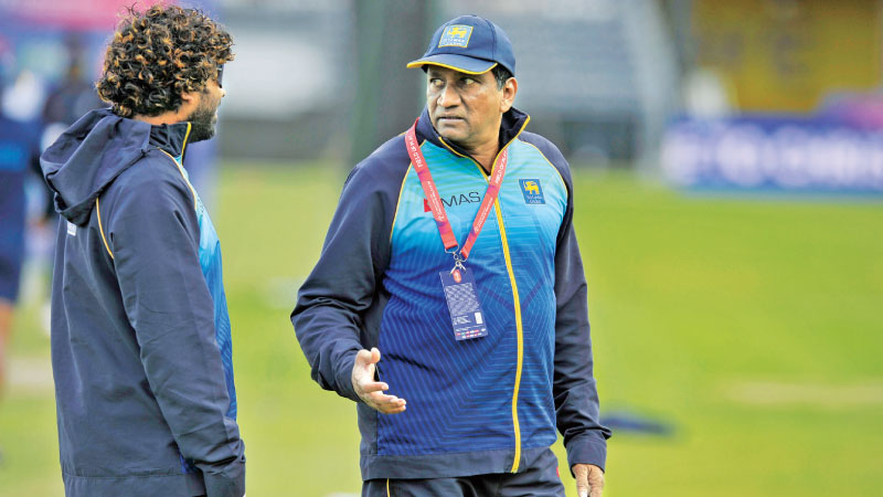 Chief selector and manager Ashantha de Mel (right) has a chat with key bowler Lasith Malinga during practice at the County Cricket ground in Bristol yesterday.
