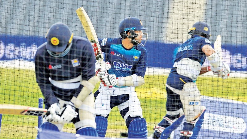Sri Lanka's Kusal Mendis (centre) batting in the nets at Bristol ahead of today's World Cup game against Pakistan.