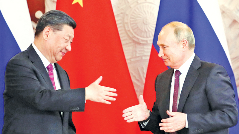 Chinese President Xi Jinping meeting Russian President Vladimir Putin in Moscow yesterday.