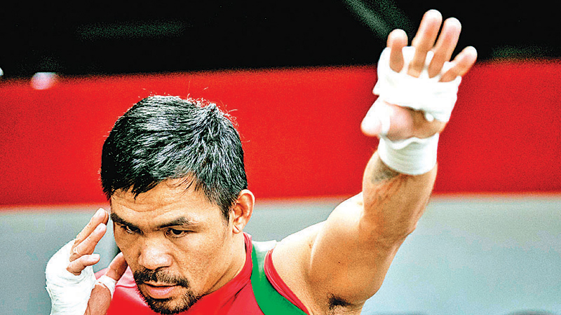 This photo taken late on Thursday shows Philippine boxing icon Manny Pacquiao training at a gym in Manila, ahead of his World Boxing Association title bout next month against Keith Thurman in Las Vegas. - AFP