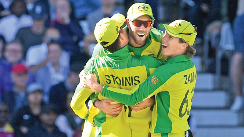 Australia's Glenn Maxwell (C) celebrates with teammates after taking the catch to dismiss West Indies' Andre Russell during the 2019 Cricket World Cup group stage match between Australia and West Indies at Trent Bridge in Nottingham, central England, on Thursday. - AFP