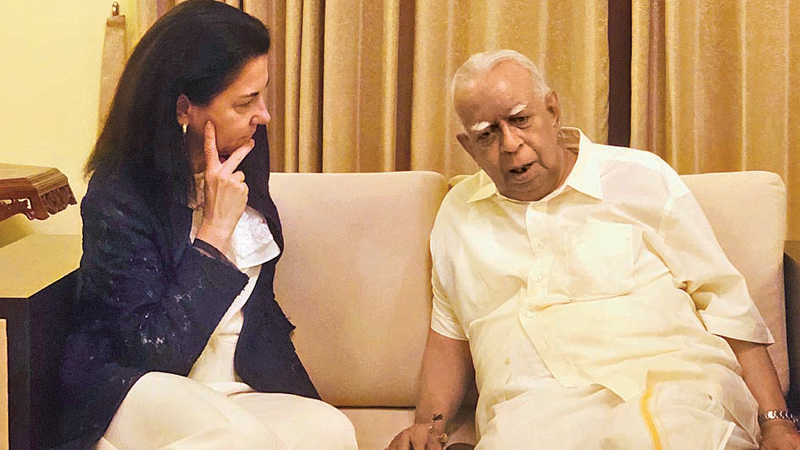 TNA leader R. Sampanthan with UN official Michele Coninsx in Colombo on Saturday.
