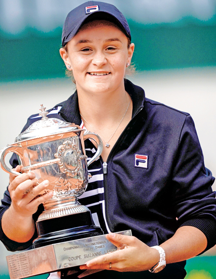 Australia's Ashleigh Barty poses with the trophy Suzanne Lenglen after winning against Czech Republic's Marketa Vondrousova at the end of the women's singles final match on day fourteen of The Roland Garros 2019 French Open tennis tournament in Paris on June 8, 2019. AFP