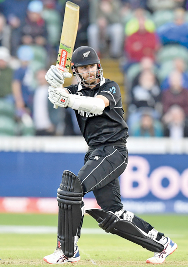 New Zealand's captain Kane Williamson pulls to long leg to end the match  during the 2019 Cricket World Cup group stage match between Afghanistan and New Zealand at The County Ground in Taunton, . AFP