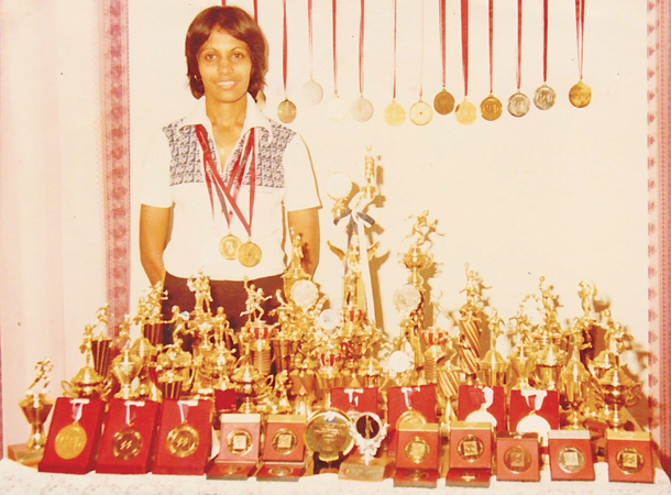 Yamuna Wickremasinghe during her playing days with the trophies she had won