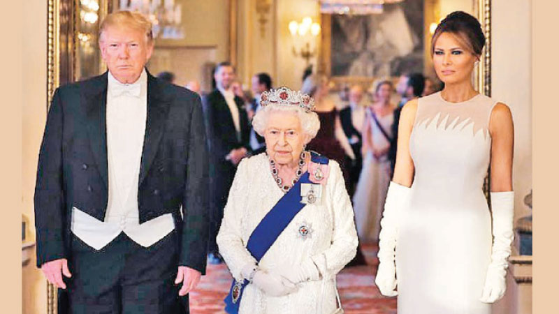STATE BANQUET -Melania's gown cost around $31,800-$38,000 (£25,000 - £30,000), while the cost of her shoes, gloves and jewellery is unknown